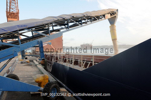 Ship being loaded with wood pellets at the Saltburn pier in Invergordon for wood product suppliers,  Balcas. 10/12/09.Picture Credit Andrew Duke/HIE Balcas,Invergordon,wood pellets,pellets,loading,ship,crane,green,energy,brites,fuel,alternative,pellet,wood,2009,biomass,highlands,port,dock,industry