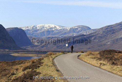 North Coast 500 along Loch Eriboll, Sutherland, Highlands of Scotland uk,u.k,Great Britain,GB,G.B,Scotland,Scottish,1 person,daytime,outdoors,sutherland,north coast 500,route,road,mountain,mountains,hill,hills,snow,loch,eriboll,activity,activities,cycling,cyclist,cyclists,bike,bikes,biking,biker,bikers,bicycle,bicycles,people,person,highland,highlands