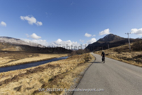 Cycling on A838 along River Laxford, Sutherland, Highlands of Scotland uk,u.k,Great Britain,GB,G.B,Scotland,Scottish,1 person,daytime,outdoors,sutherland,cycling,cyclist,cyclists,bike,bikes,biking,biker,bikers,bicycle,bicycles,people,person,empty,road,highland,highlands