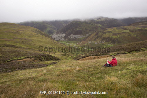 Looking across Mennock Pass to Wether Hill and White Dod. Scotland uk,u.k,Great Britain,GB,G.B,Scotland,Scottish,1 person,outdoors,walk,walking,walker,climb,climber,fresh,air,hill,hills,mountain,mountains,Lowther,rolling,heather,bracken,Mennock,Pass,Water,male,red,jacket,middle,aged,fit,fitness,health,healthy,Nithsdale,Dumfries,and,Galloway,ridge,misty,autumn,autumnal,ancient,path,track,old,view,steep,Dempster