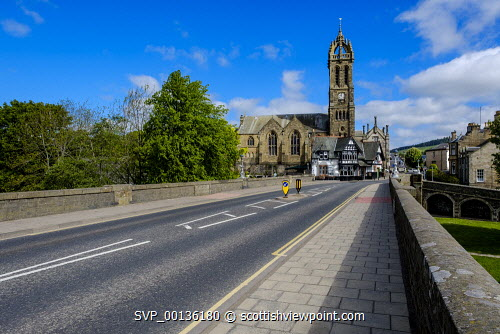 Bridge over the River Tweed in the borders town of Peebles, Scotland looking towards the Old Parish Church uk,u.k,Great Britain,GB,G.B,Scotland,Scottish,nobody,daytime,outdoors,bridge,may,Peebles,River Tweed,Scottish Borders,spring,springtime,sunshine