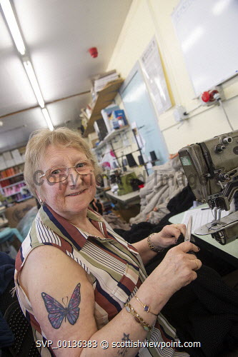 Laurence Odie Knitwear, Shetland Isles  Elain Skene working at a machine 2019,Laurence Odie Knitwear,Shetland,island,islands,isle,isles,details,knitwear,knitting,knit,woollen,wool,garments,garment,clothes,product,production,manufacture,machine Dave Donaldson