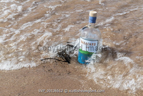 Badachro Gin , Wester RossPictured  a bottle of gin in the water Picture Credit John Paul/HIE 2019,gin,distillery,distilleries,production,artisan,drink,badachro,distillers,process,alchohol,bottle,water,shore,waves John Paul