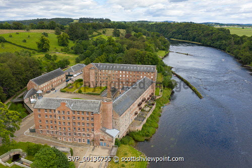 Aerial view of historic preserved Stanley Mills former cotton mills factory situated next to River Tay in Stanley, Perthshire, Scotland, UK Stanley Mills,Stanley perthshire,Scotland,Scottish,former cotton mill,old cotton mill,old factory,industrial buildings,preserved,museum,UK,United Kingdom,daytime,Britain,british,industrial heritage,historic cotton mills