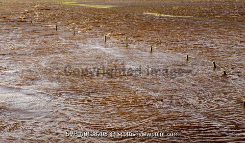 Storm Ciara causes the River Medwin (a tributary of the River Clyde) to burst its banks in South Lanarkshire causing wide spread flooding on roads and fields. Flood,Flooding,Storm Ciara,heavy,rain,weather,South Lanrkshire,River Medwin,Medwin Burn,tributary,River Clyde,South Lanarkshire,Scotland,winter weather,flooded,fields