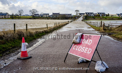 Storm Ciara causes the River Clyde to burst its banks in South Lanarkshire causing wide spread flooding on roads and fields. Flood,Flooding,Storm Ciara,heavy rain,weather,weather picture,River Clyde,Thankerton,Scotland,South Lanarkshire,burst banks,winter weather,flooded road
