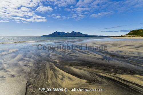 Sand patterns at Laig Bay with view to Rum, Isle of Eigg, Inner Hebrides uk,u.k,Great Britain,GB,G.B,Scotland,Scottish,nobody,daytime,outdoors,summer,restful,remote,peaceful,tranquil,bright,sunny,small isles,west coast,blue sky,dramatic,distant,bay,stream,rivulet,sea,sandy,shore,abstract,nature,laig bay,rhum,patterns in the sand,inner hebrides,beach,beaches,sand,coast,coastal,coastline,water