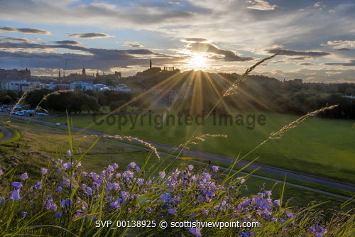 Holyrood Park looking to Calton Hill and city skyline, Edinburgh united kingdom,edinburgh,scotland,lothians,capital city of scotland,auld reekie,chilling,ambient light,dramatic,hillside,moorland,nature,pillars,monument,calton hill,national monument,nelson monument,holyrood,holyrood park,dusk,sunset,nobody