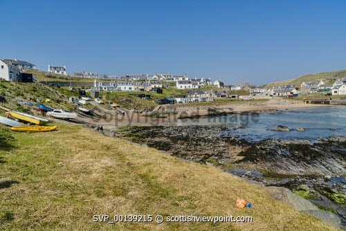 Collieston coastal village, harbour and beach,  Aberdeenshire, Scotland UK Panorama,Collieston,village,harbour,beach,fishing,sands,Aberdeenshire,north,east coast,coastal,boats,coastline,holiday,rocks,sunny,Scottish,UK,United Kingdom,people,sea,villages
