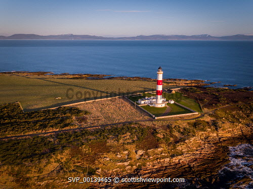 Early morning light over Tarbat Ness Lighthouse using a drone Portmahomack,Robert Stevenson,Spring,Tain,aerial,aerial photograph,am,beautiful,beauty,coast,coastal,coastline,dawn,drone,geography,highlands,light-house,lighthouse,morning,morning light,natural light,nature,peninsula,remote,rocky,rugged,rugged coastline,scenery,scenic,scotland,scottish,scottish coast,scottish highlands,seascape,shoreline,sunrise,tarbat ness,travel,uk