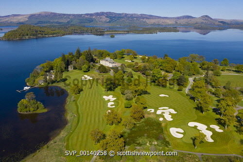 Aerial view of Loch Lomond Golf Club on shores of Loch Lomond, Argyll and Bute, Scotland, UK Loch Lomond Golf Club,Loch Lomond Golf course,Loch lomond,Scotland,Scottish golf Course,courses,upmarket,exclusive golf club,drone image,elevated view,nobody,Uk,United Kingdom,country club,britain british,scottish golf club,europe,european,aerial view,sunshine