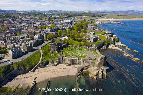 Aerial view of St Andrews Castle and city in St Andrews , Fife, Scotland, UK St Andrews,St Andrews Scotland,St Andrews Castle,aerial view,drone image,daytime,from above,elevated viewpoint,fife,scottish town,UK,United kingdom,britain,British,historical monument,castles,landmark,tourist attraction,historic,coast,coastal,scotland st andrews st andrews fife,fife town,royal borough,skyline,cityscape