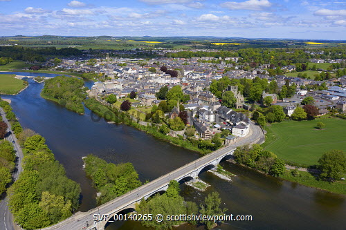 Aerial view of town of Kelso beside River Tweed in Scottish Borders, Scotland, UK Kelso scotland,Scotland,Scottish town,Scottish Borders,River Tweed,daytime,UK,United Kingdom,britain,British,travel,tourism,nobody,sunny weather,Coldtream,Scotland Kelso,aerial view,drone image,towns,rural community
