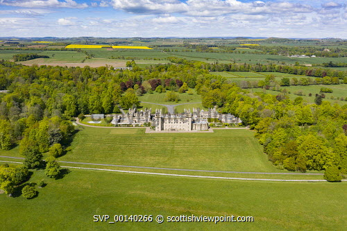 Aerial view of town of Floors Castle in Kelso in Scottish Borders, Scotland, UK Floors castle scotland,Scotland,Scottish town,Scottish Borders,River Tweed,daytime,UK,United Kingdom,britain,British,travel,tourism,nobody,sunny weather,Coldtream,Scotland Kelso,aerial view,drone image,towns,rural community,scottish castle,castles,floors castle,stately home,stately homes,floors castle kelso