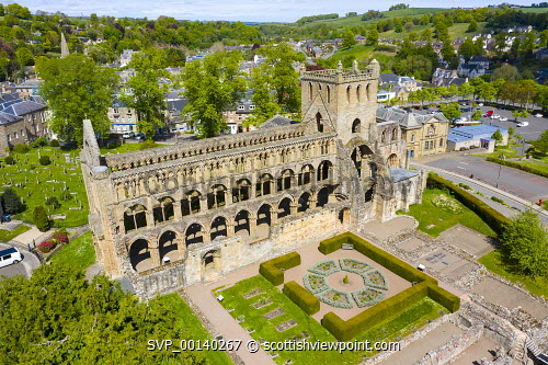 Aerial view of Jedburgh Abbey in Scottish Borders, Scotland, UK Jedburgh,Jedburgh Abbey,Scottish Borders,Jedburgh Scotland,Uk,United Kingdom,Britain,British,travel tourism,abbeys,ruin,ruined abbey,aerial view,drone image,daytime,exterior,nobody,elevated view,landmark,medieval,historical monument,tourist attraction
