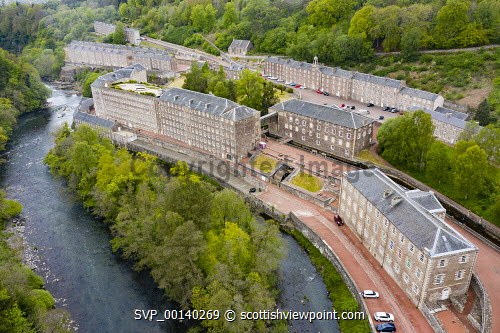 Aerial view of New Lanark World Heritage Site beside River Clyde in South Lanarkshire, Scotland, UK New Lanark,new Lanark Scotland,Scotland,Scottish,unesco world heritage site,historical site,travel,tourism,Uk,United Kingdom,aerial view,drone image,Britain,British,former mill town,tourist attraction