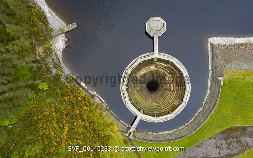 Aerial view of glory hole spillway at Whiteadder Reservoir and dam , Scotland, UK Scotland,Scottish,East Lothian,Whiteadder reservoir,reservoirs,low water level,spillway,bellmouth spillway,morning glory spillway,water supply,water supplies,scottish water,dam,dams,Lammermuir hills,aerial view,drone image,civil engineering,scottish reservoir,dry weather