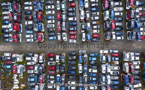 Aerial view of many cars stored in a car breaking yard or scrap yard in Scotland, UK. car scrap yard,car breaking yard,recycling,cars,recycled,automobile,automobiles,vehicles,aerial view,drone,image,looking down,elevated viewpoint,old cars,scrapyard,Uk,United Kingdom,UK scrappage scheme,scrapped cars,scrap cars,autos,auto breaking yard