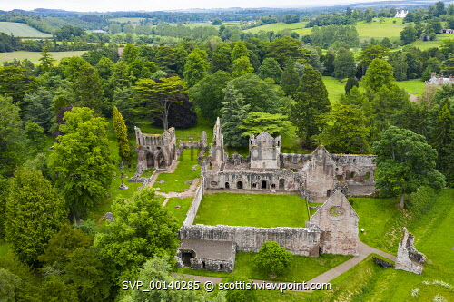 Aerial view of ruin of Dryburgh Abbey in Dryburgh , Scottish Borders, Scotland UK Dryburgh Abbey Scotland,Scottish,Scotland,Aerial view,elevated viewpoint,drone,image,Scottish Borders,ruin,ruined abbey,historic environment scotland,UK,United Kingdom,Britain,monument,scottish culture,ruins,Dryburgh Abbey,from above,daytime,nobody,ruined church,landmark,travel,tourism