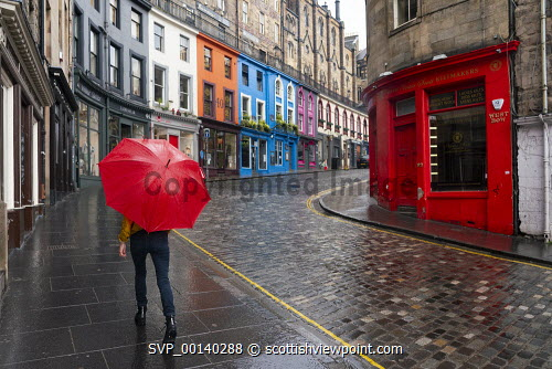 View of empty Victoria Street in Edinburgh during Covid-19 lockdown, Scotland UK Scotland,Scottish,Edinburgh,shops,shopping,retail industry,UK,United kingdom,britain,coronavirus,covid-19,shop,store,empty street,victoria street edinburgh,edinburgh old town,red umbrella,quiet,deserted