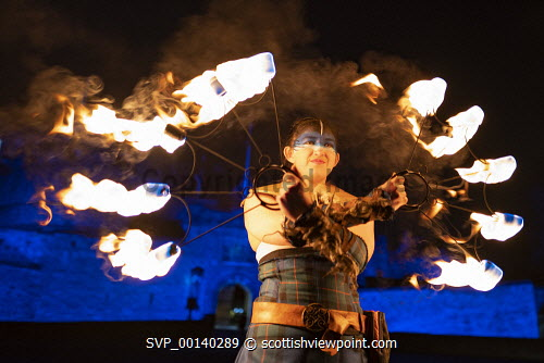 Fire artists taking part in Hogmanay Torchlight Procession perform at Edinburgh Castle prior to procession along the  Royal Mile in the Old Town , Scotland, UK Scottish culture,torchlight procession,edinburgh torchlight procession,Edinburgh hogmanay,Scotland,night,torchlight procession edinburgh,old town,new year,celebration,uk,new year ediburgh,edinburgh new year