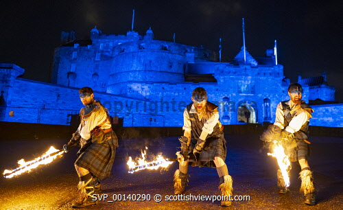 Fire artists taking part in Hogmanay Torchlight Procession perform at Edinburgh Castle prior to procession along the  Royal Mile in the Old Town , Scotland, UK Edinburgh,hogmanay,Scotland,Scottish,torchlight procession,old town,new year,culture,edinburgh torchlight procession,night,celebration,uk