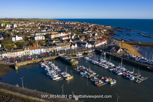 Aerial view from drone of Anstruther in the East Neuk of Fife, Scotland, UK Anstruther,Scotland,Scottish,drone image,aerial,from above,fishing village,coast,coastal,UK,united kingdom,travel,tourism,East neuk Fife,Fife,daytime,villages,scottish fishing village,harbour,Firth of Forth,community,scotish culture,traditional heritage,historical,old,quaint