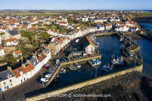 Aerial view from drone of Pittenweem fishing village in the East Neuk of Fife, Scotland, UK Pittenweem,Scotland,Scottish,drone image,aerial,from above,fishing village,coast,coastal,UK,united kingdom,travel,tourism,East neuk Fife,Fife,daytime,villages,scottish fishing village,harbour,Firth of Forth,community,Scottish culture,traditional heritage,historical,old,quaint