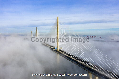 Queensferry Crossing bridge shrouded in mist , South Queensferry, Scotland, UK South Queensferry,Scotland,Scottish,Queensferry Crossing bridge,weather,cloud inversion,fog,mist,foggy weather,UK,United Kingdom,britain,british,daytime,transport,infrastructure,drone image,from above,misty