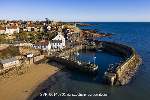 Aerial view from drone of Crail historic fishing village in the East Neuk of Fife, Scotland, UK Crail,Scotland,Scottish,drone image,aerial,from above,fishing village,coast,coastal,UK,united kingdom,travel,tourism,East neuk Fife,Fife,daytime,villages,scottish fishing village,harbour,Firth of Forth,community,scottish culture,traditional heritage,historical,old,quaint