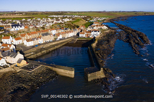 Aerial view of village from drone of  of Cellardyke fishing village in the East Neuk of Fife, Scotland, UK Cellardyke,Scotland,Scottish,drone image,aerial,from above,fishing village,coast,coastal,UK,united kingdom,travel,tourism,East neuk Fife,Fife,daytime,villages,scottish fishing village,harbour,Firth of Forth,community,scottish culture,traditional heritage,historical,old,quaint