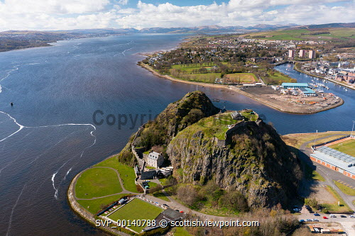 Aerial view from drone of Dumbarton Castle (closed during Covid-19 lockdown) on Dumbarton Rock beside River Clyde, Scotland, UK Dumbarton Castle,Dumbarton Castle Scotland,Dumbarton,Dumbarton Rock,River Clyde Scotland,Scotland,aerial view,from drone,from above,birds eye view,from the air,high angle viewpoint,daytime,no person,UK,united Kingdom,britain,british,historical monument,famous place,travel,tourism,scottish castle,castles,tourist attraction,destination,scottish culture,scottish history,medieval,landmark,Europe,European