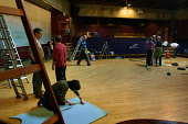 Visitors and members of the Findhorn Foundation, a community established to promote spiritual and personal development and community living, prepare the community's Universal Hall for a workshop. The... Colin McPherson