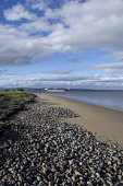 Looking north from Cromarty over the Cromarty Firth to a tanker at Nigg Oil Terminal, the Black Isle, Highland. PIC : D BARNES/SCOTTISH VIEWPOINT Tel: +44 (0) 131 622 7174   Fax: +44 (0) 131 622 7175... D BARNES/SCOTTISHVIEWPOINT beach,sand,sandy,sunny,shingle