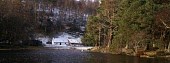 A snow covered bothy by the shores of Loch an Eilein near Aviemore in the Highlands, early morning light illuminates the Caledonian pines by the water's edge. PIC: IAN PATERSON/SCOTTISH VIEWPOINT Tel:... COLD,WOODLAND,WOOD,WATER,TREE,SNOW,SCOTLAND,PANORAMIC,ISOLATED,ICE,HOUSE,FOREST,COTTAGE