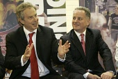 Tony Blair Prime Minister with Jack McConnell  Scottish Labour leader at a private meeting on anti social behaviour in Rutherglen checks out the tearoom during his visit to Rutherglen ahead of the Sco... SCOTLAND,POLITICS