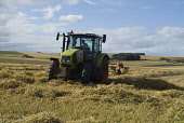 Tractor spreading barley stock for drying, Todhead Point, Aberdeenshire. PIC: DOUG HOUGHTON/SCOTTISH VIEWPOINT  Tel: +44 (0) 131 622 7174  Fax: +44 (0) 131 622 7175  E-Mail : info@scottishviewpoint.co... DOUG HOUGHTON/SCOTTISH VIEWPOINT farm,land,agriculture,agricultural,rural,farming,golden,fields,harvesting,country,countryside,side,outside,outdoors,grow,growing,growth,cutting,reaping,arable,agronomy,hay,stubble,industry,cultivating