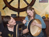 Musicians playing Bodhran drums at the Ferry Inn public house during the Orkney Folk Festival, Stromness, Orkney. PIC: DOUG HOUGHTON/SCOTTISH VIEWPOINT  Tel: +44 (0) 131 622 7174  Fax: +44 (0) 131 622... DOUG HOUGHTON/SCOTTISH VIEWPOINT music,drum,bodhran,irish,gaelic,keltic,celtic,celts,kelts,handheld,hand,held,beater,stick,goat,skin,tight,skinned,drumhead,drums,drummer,drummers,percussion,rhythm,tradition,heritage,traditional,cultu