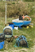 A beached fishing boat with lobster and crab creels, Glimps Holm, Orkney. PIC: DOUG HOUGHTON/SCOTTISH VIEWPOINT  Tel: +44 (0) 131 622 7174  Fax: +44 (0) 131 622 7175  E-Mail : info@scottishviewpoint.c... DOUG HOUGHTON/SCOTTISH VIEWPOINT fish,catching,shellfish,sea,fishery,industry,nets,baskets,cages,fisheries,marine,traditional,fishing,pots,community,catch,caught,captured,capture,ashore,shore,abandoned,north,scotland,islands,northern