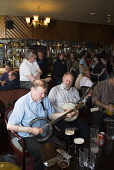 Musicians playing banjos and guitar in the lounge bar of the Stromness Hotel during the Orkney Folk Festival, Stromness, Orkney. PIC: DOUG HOUGHTON/SCOTTISH VIEWPOINT  Tel: +44 (0) 131 622 7174  Fax:... DOUG HOUGHTON/SCOTTISH VIEWPOINT banjo,banjoist,banjoists,plucking,strings,string,tradition,heritage,traditional,culture,cultural,event,events,entertain,entertainment,performance,performances,jam,jamming,session,sessions,instrument,i