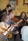 Musicians playing fiddles and guitar in the Ferry Inn public house during the Orkney Folk Festival, Stromness, Orkney. PIC: DOUG HOUGHTON/SCOTTISH VIEWPOINT  Tel: +44 (0) 131 622 7174  Fax: +44 (0) 13... DOUG HOUGHTON/SCOTTISH VIEWPOINT violin,violins,violinist,violinists,fiddle,fiddles,fiddler,fiddlers,bow,bows,strings,string,tradition,heritage,traditional,culture,cultural,event,events,entertain,entertainment,performance,performance