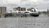 Visitors on the beach at  Kirkcaldy in Fife as a  hovercraft leaves on its way to Portobello in Edinburgh,as part of a commercial ferry trial across the Firth of Forth by Stagecoach Group .It is hoped... ALLAN MILLIGAN/SCOTTISH VIEWPOIN POLITICS,SCOTLAND