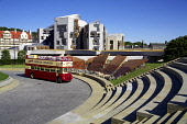 A Edinburgh tour bus arrives at Our Dynamic Earth with the Scottish Parliament behind. CRAIG BROWN/SCOTTISH VIEWPOINT  Tel: +44 (0) 131 622 7174  Fax: +44 (0) 131 622 7175  E-Mail : info@scottishviewp... CRAIG BROWN/SCOTTISH VIEWPOINT & ad,advert,advertising,arc,arched,architect,architecture,art,artistic,arty,attraction,auld,azure,blue,britain,brochure,budget,building,bus,capital,cb,chamber,circular,city,coach,cobalt,controversial,co