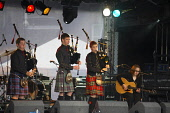 TNT Bagpipe Boy Band onstage at picnic in the park CRAIG BROWN/SCOTTISH VIEWPOINT  Tel: +44 (0) 131 622 7174  Fax: +44 (0) 131 622 7175  E-Mail : info@scottishviewpoint.com  www.scottishviewpoint.com... CRAIG BROWN/SCOTTISH VIEWPOINT & Bagpipe,Band,Boy,TNT,academy,act,artist,artiste,drama,entertain,entertainer,entertainment,event,gig,group,holyrood,in,instrument,music,musical,on,park,parliament,performance,performer,performing,picni