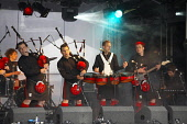 Red Hot Chilli Pipers onstage at Picnic in the park CRAIG BROWN/SCOTTISH VIEWPOINT  Tel: +44 (0) 131 622 7174  Fax: +44 (0) 131 622 7175  E-Mail : info@scottishviewpoint.com  www.scottishviewpoint.com... CRAIG BROWN/SCOTTISH VIEWPOINT & Chilli,Hot,Pipers,Red,act,artist,artiste,band,celebration,entertain,entertainer,entertainment,event,gig,group,holyrood,in,instrument,music,musical,on,park,parliament,performance,performer,performing,p