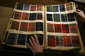 A 19th century Pattern Book record of tartan cloth woven by Kinloch Anderson as Jim Mather MSP Enterprise Minister and Jamie McGrigor MSP Conservative, visit Kinloch Anderson in Leith to announce how... POLITICS