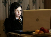A young girl is engrossed in her computer. PIC I MCLEAN/SCOTTISHVIEWPOINT Tel: +44 (0) 131 622 7174 Fax: +44 (0) 131 622 7175 E-Mail : info@scottishviewpoint.com  This photograph cannot be used withou... child,computing,homework