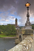 THE RIVER TWEED, TWEED BRIDGE AND OLD PARISH CHURCH IN THE SCOTTISH BORDERS TOWN OF PEEBLES, EARLY MORNING, AUGUST. PIC: RICHARD CLARKSON/SCOTTISH VIEWPOINT Tel: +44 (0) 131 622 7174   Fax: +44 (0) 13... vertical,water,trees,deciduous,stone,stonework,building,buildings,history,weather,clouds,threatening,light,streetlight,lamp,ornate,decorative,detail