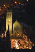 NIGHTTIME VIEW TOWARDS PEEBLES HIGH STREET AND THE OLD PARISH CHURCH, THE BORDERS, AUGUST. PIC: RICHARD CLARKSON/SCOTTISH VIEWPOINT Tel: +44 (0) 131 622 7174   Fax: +44 (0) 131 622 7175 E-Mail : info@... vertical,town,houses,building,buildings,shops,church,spire,townscape,lights,cars,traffic,trails,streetlights,night