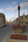 EARLY MORNING VIEW ALONG PEEBLES HIGH STREET TOWARDS THE OLD PARISH CHURCH, THE BORDERS, AUGUST. PIC: RICHARD CLARKSON/SCOTTISH VIEWPOINT Tel: +44 (0) 131 622 7174   Fax: +44 (0) 131 622 7175 E-Mail :... vertical,town,shops,building,buildings,townscape,summer,flowers,monument